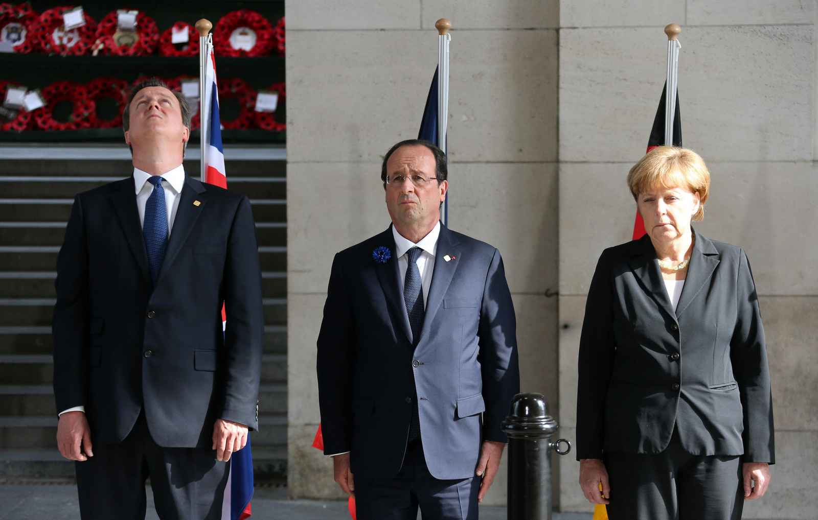 "Britain's PM Cameron, France's President Hollande and Germany's Chancellor Merkel attend a ""Last Post"" ceremony at the Menin Gate in Ypres"