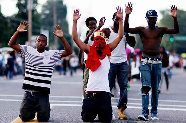 ferguson-hands-up-dont-shoot-protests-2014-nillboard-650