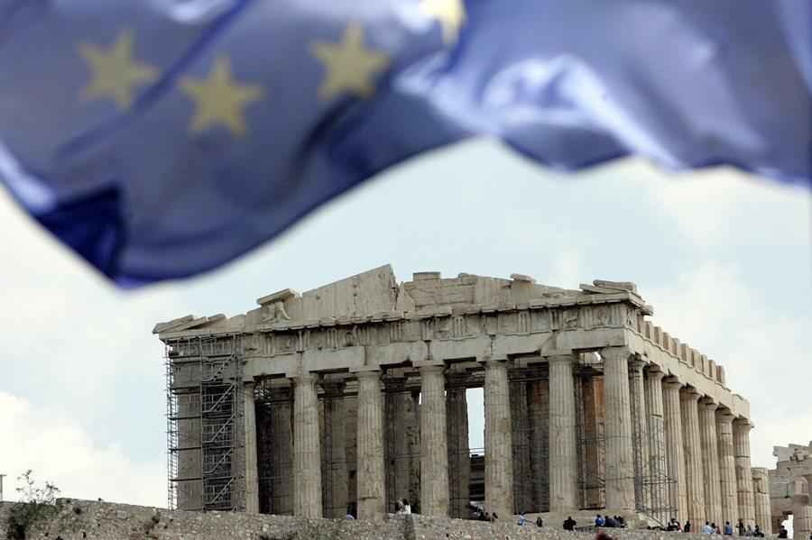 epa02109655 A European Union flag is flying over the temple of Parthenon on Acropolis hill in Athens on 09 April 2010. The Greek government is implementing austerity measures, amidst protests, that envision a major overhaul of the taxation and social security and pension systems. Greece has vowed to tackle the debt crisis that has shaken the entire European Union and put the euro currency under pressure.  EPA/ORESTIS PANAGIOTOU