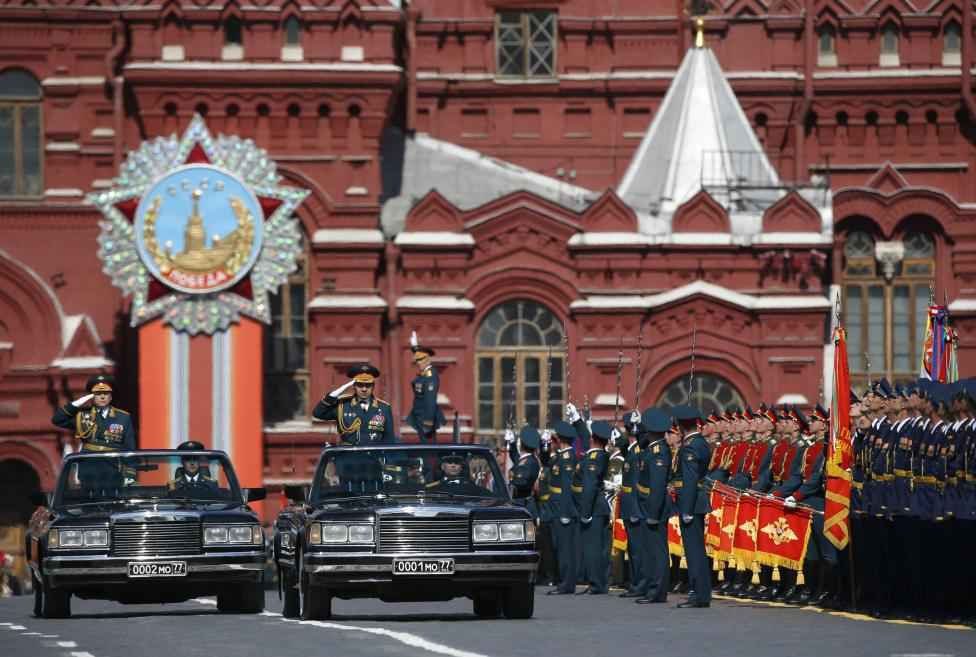 Russian Defence Minister Sergei Shoigu (front car, L) salutes as he takes part in the Victory Day parade at Red Square in Moscow, Russia, May 9, 2015.  REUTERS/Sergei Karpukhin