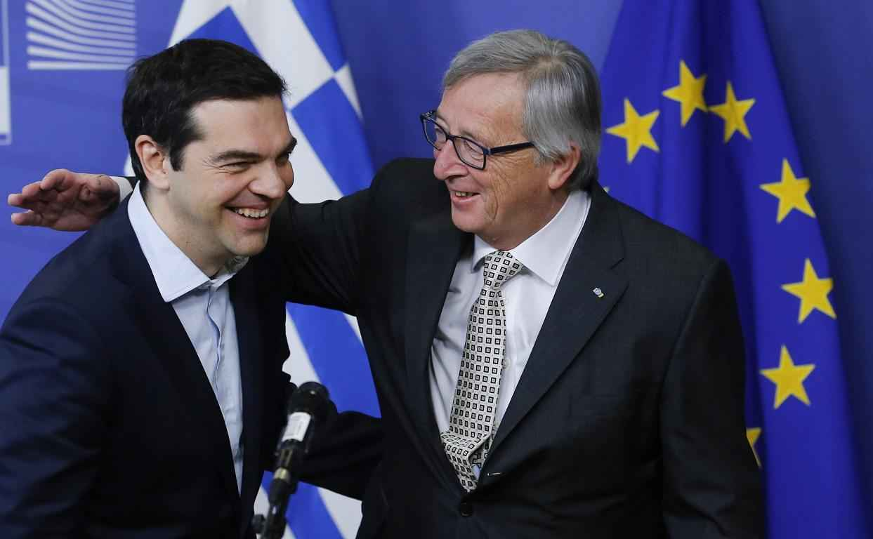 epa04660231 European Commission President Jean claude Juncker (R) welcomes Greek Prime Minister Alexis Tsipras prior to a meeting at EU commission headquarters in Brussels, Belgium, 13 March 2015.  EPA/OLIVIER HOSLET