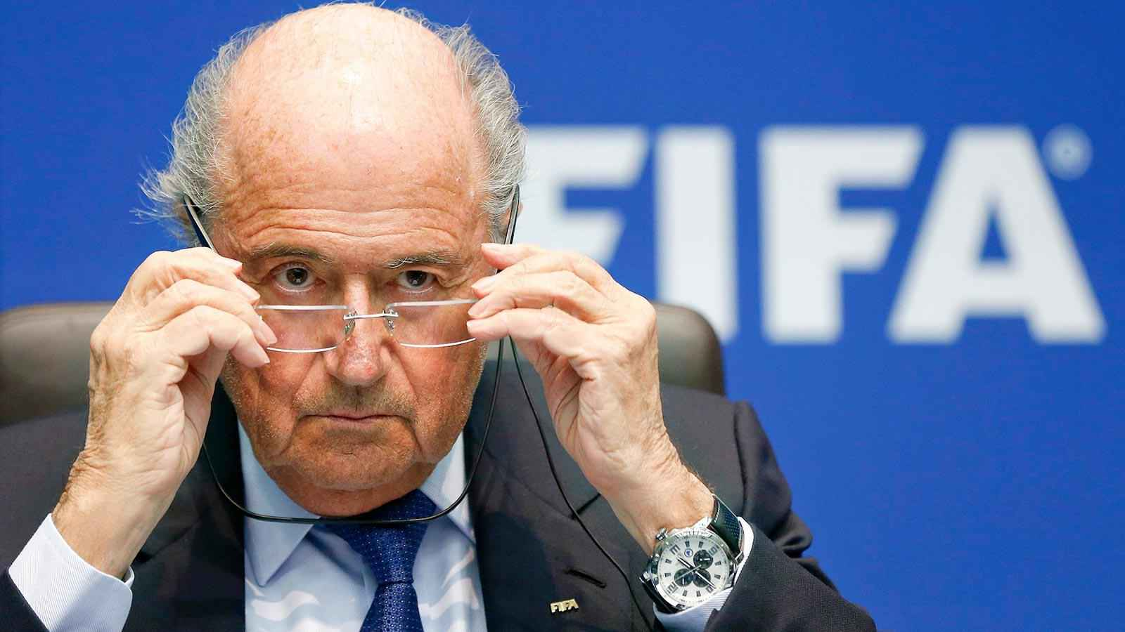 FIFA President Sepp Blatter adjusts his glasses as he addresses a news conference after a meeting of the FIFA executive committee in Zurich March 21, 2014. REUTERS/Arnd Wiegmann  (SWITZERLAND - Tags: SPORT SOCCER HEADSHOT)  Picture Supplied by Action Images