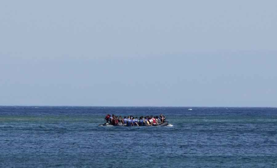 epa04850647 Syrian refugees take a boat to reach Greek Island Lesvos at Green Harbour Beach near Behramkale, coastal district of Ayvacik, Canakkale, Turkey, 17 July 2015. According to the UN refugee agency, Turkey has taken in 1.8 million refugees from war-torn Syria - more than any other country. Many Syrian asylum seekers try to reach the European Union by first entering Turkey. EPA/TOLGA BOZOGLU