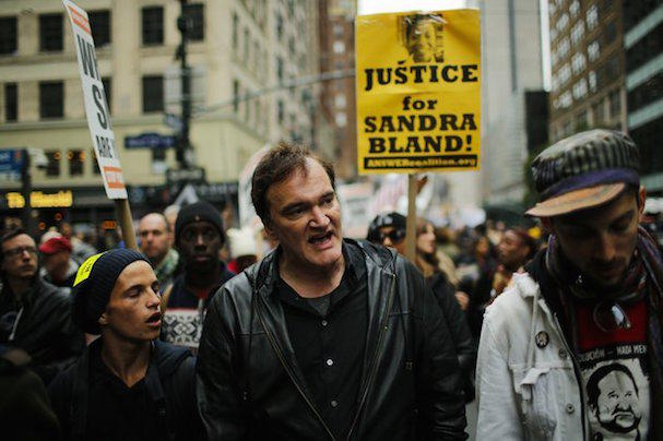"US film director Quentin Tarantino (C) takes part in a march against police brutality called ""Rise up October"" on October 24, 2015, in New York. Campaigners demanding an end to police killings of unarmed suspects demonstrated and marched through Manhattan.  AFP PHOTO/EDUARDO MUNOZ ALVAREZ        (Photo credit should read EDUARDO MUNOZ ALVAREZ/AFP/Getty Images)"