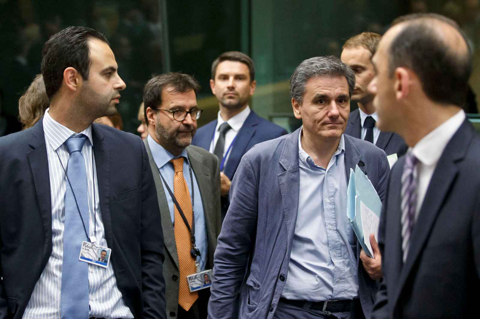 Greek Finance Minister Euclid Tsakalotos, third right, arrives for a round table meeting of eurozone finance ministers at the EU LEX building in Brussels on Tuesday, July 7, 2015. Greek Prime Minister Alexis Tsipras was heading Tuesday to Brussels for an emergency meeting of eurozone leaders, where he will try to use a resounding referendum victory to eke out concessions from European creditors over a bailout for the crisis-ridden country. (AP Photo/Michel Euler)