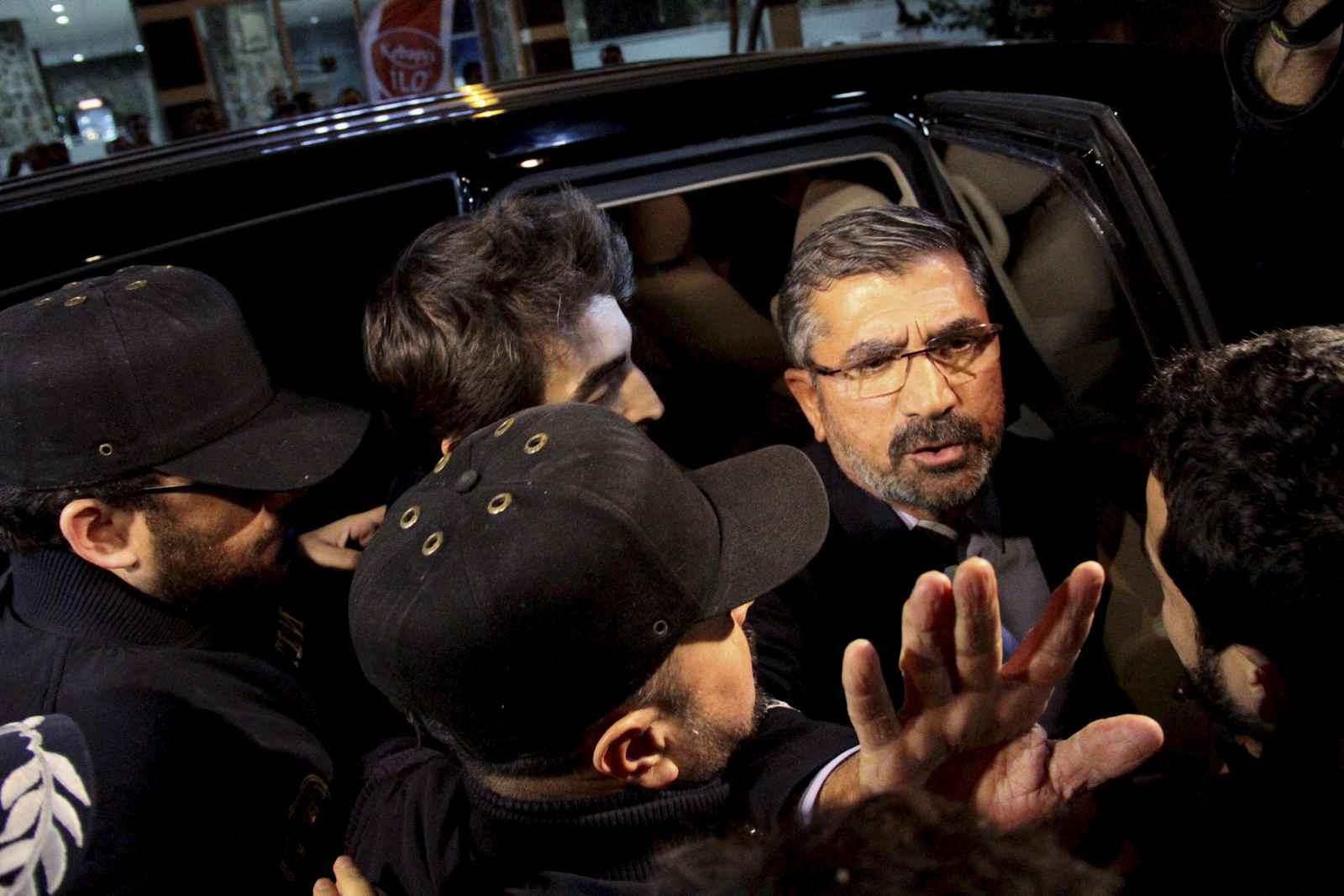 Tahir Elci, the head of Diyarbakir Bar Association, (2nd R) is escorted by plainclothes police officers as he leaves his office in Diyarbakir, Turkey, early October 20, 2015 in this file photo.   An unidentified gunman on November 28, 2015 killed the top Kurdish lawyer who had been criticised in Turkey for saying the banned Kurdistan Workers Party (PKK) was not a terrorist organisation. Witnesses said Bar Association President Elci was shot in the head after making a statement to the media in Diyarbakir, the largest city in Turkey's troubled, mainly Kurdish southeast. Picture taken October 20, 2015. REUTERS/Sertac Kayar/Files