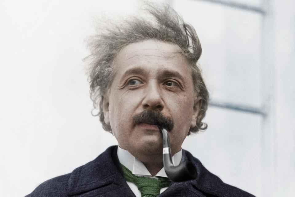 Albert Einstein Theoretical physicist (1879-1955) Smoking A Pipe