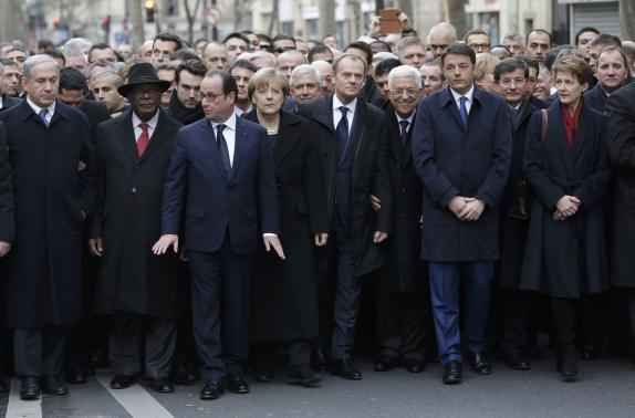 French President Francois Hollande is surrounded by Heads of state including (LtoR) Israel's Prime Minister Benjamin Netanyahu, Mali's President Ibrahim Boubacar Keita, Germany's Chancellor Angela Merkel, European Council President Donald Tusk, Palestinian President Mahmoud Abbas, Italy's Prime Minister Matteo Renzi and Switzerland's President Simonetta Sommaruga as they attend the solidarity march (Marche Republicaine) in the streets of Paris January 11, 2015. REUTERS/Philippe Wojazer
