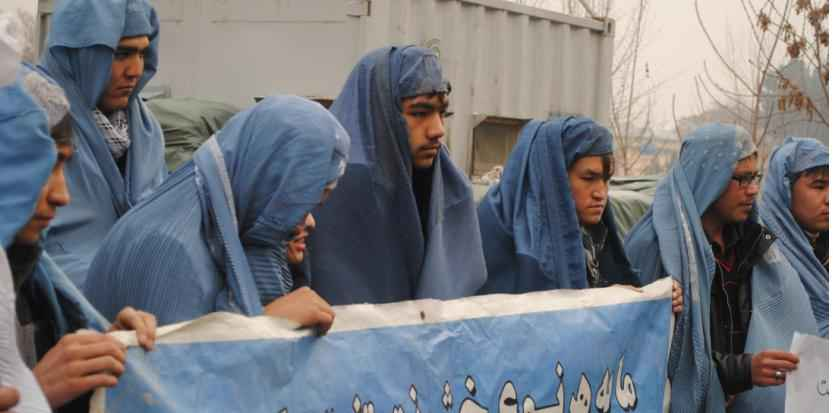 KABUL, AFGHANISTAN - MARCH 05: A group of Afghan men wearing burqas, gather outside the Afghan Independent Human Rights Commission to protest violence against women on March 05, 2015 in Kabul, Afghanistan. Mohammad Fahim Abed / Anadolu Agency