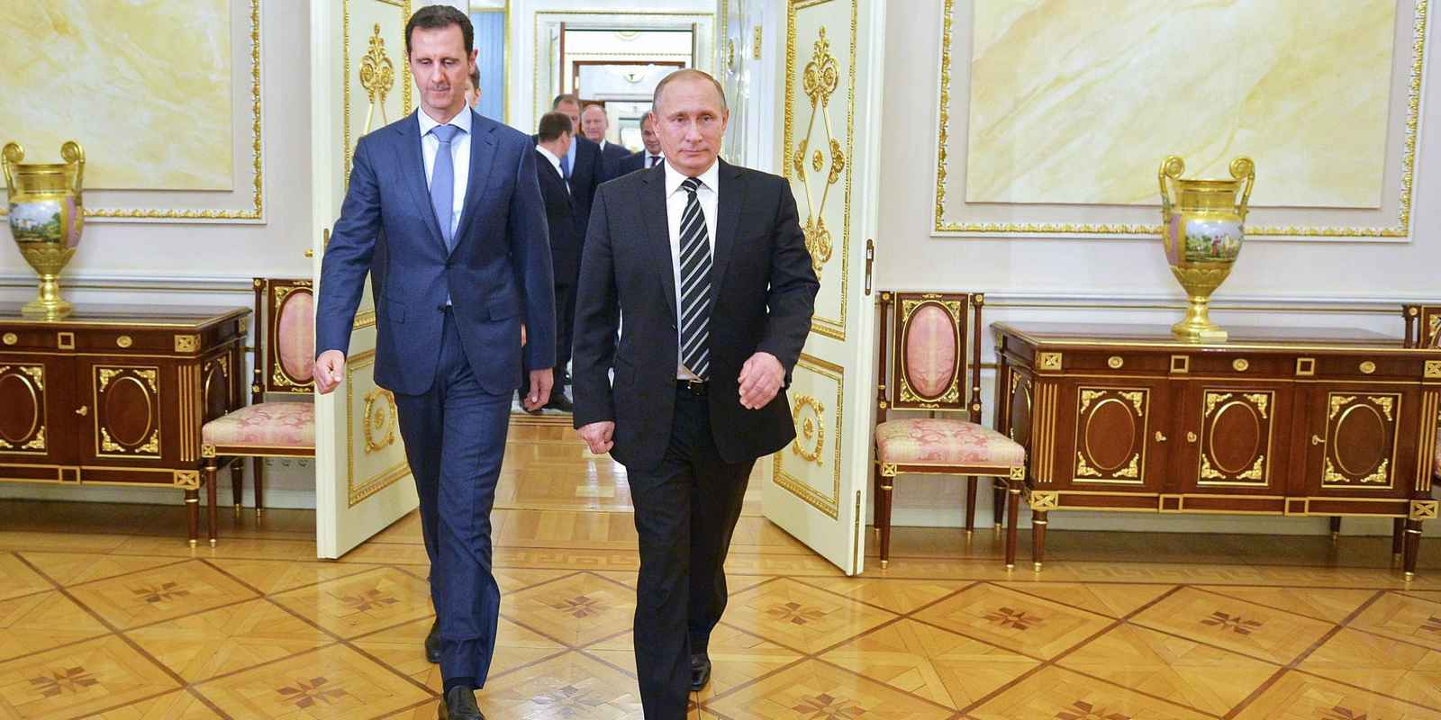 "Russian President Vladimir Putin (R) greets his Syrian counterpart Bashar al-Assad upon his arrival for a meeting at the Kremlin in Moscow on October 21, 2015. Assad, on his first foreign visit since Syria's war broke out, told his main backer and counterpart Putin in Moscow that Russia's campaign in Syria has helped contain ""terrorism"". AFP PHOTO / RIA NOVOSTI / KREMLIN POOL / ALEXEY DRUZHININ        (Photo credit should read ALEXEY DRUZHININ/AFP/Getty Images)"