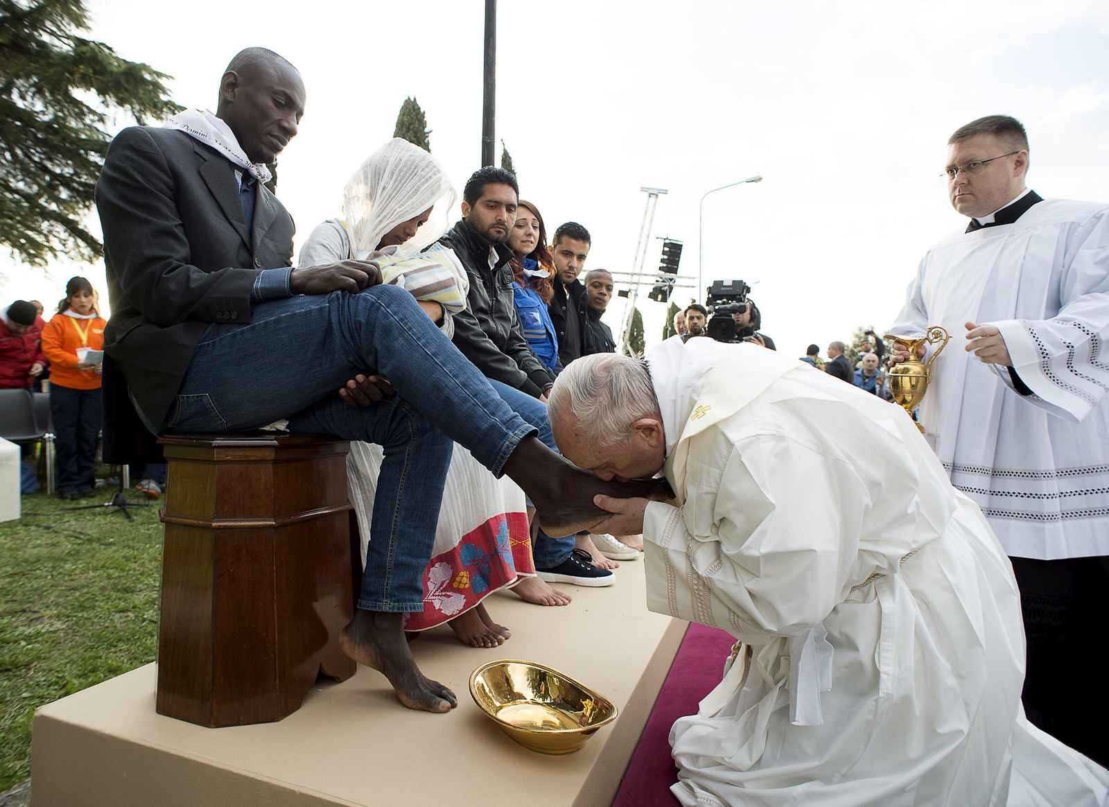Pope Francis kisses the foot of a refugee during the foot-washing ritual at the Castelnuovo di Porto refugees center near Rome, Italy