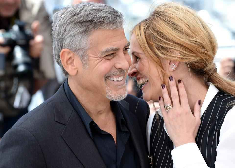 CANNES, FRANCE - MAY 12: George Clooney and Julia Roberts attend the 'Money Monster' photocall during the 69th annual Cannes Film Festival at the Palais des Festivals on May 12, 2016 in Cannes, France. (Photo by Anthony Harvey/FilmMagic)