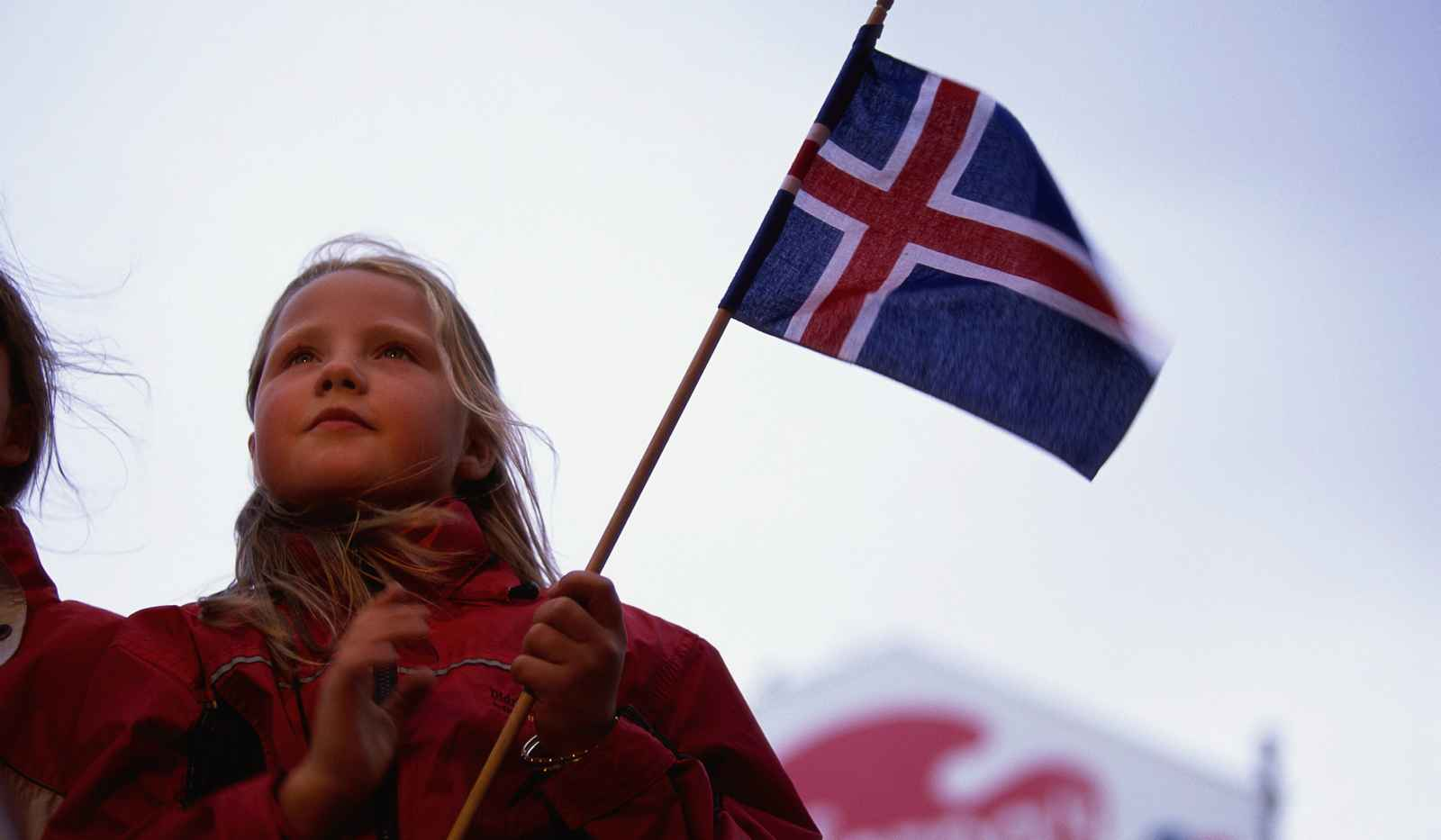 June 2003, Reykjavík, Iceland --- A young girl holding an Icelandic flag celebrates her nation's independence (June 17) on the National Day of Iceland in Reykjavik. --- Image by © Paul A. Souders/CORBIS