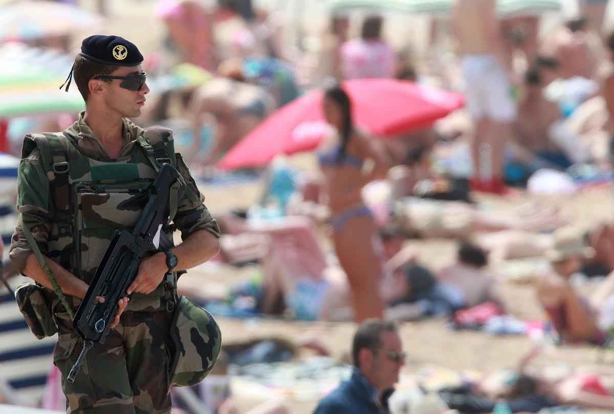 A French soldier patrols near the Biarritz's beach, southwestern France, Saturday, July 30, 2016. The challenge of protecting churches, synagogues, tourist haunts, beaches, summer festival sites, airports and train stations is among the most daunting tasks security forces have faced in recent times in France, and Europe. (AP Photo/ Bob Edme)
