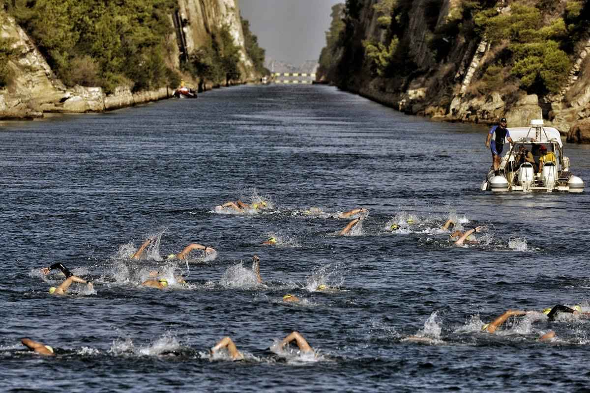 Participants of a 'swim accross the canal ' race swim through  the 6,346-meter long Corinth canal, near the city of Corinth on September 27, 2016. The canal cuts at straight line the Corinth Isthmus with the width of around 23 meters, and the depth ranging between 7 and 8 meters. The Corinthian Isthmus is a narrow strip of land that connects mainland Greece with the Peloponnese, and  the canal that has been opened shortens the sea route between the Ionian and the Aegean Seas.  / AFP / VALERIE GACHE        (Photo credit should read VALERIE GACHE/AFP/Getty Images)
