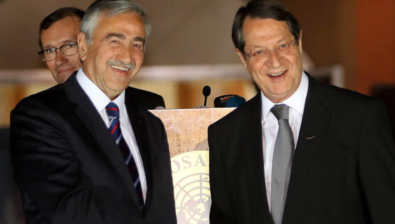 Special Advisor to the UN Secretary-General on Cyprus, Espen Barth Eide (L) stands by as the leaders of Cyprus' two communities, President Nicos Anastasiades (R) and Turkish Cypriot leader Mustafa Akinci (L), shake hands after a dinner at Ledra Palace in the UN-patrolled Buffer Zone in Nicosia, Cyprus, 11 May 2015.   EPA/KATIA CHRISTODOULOU