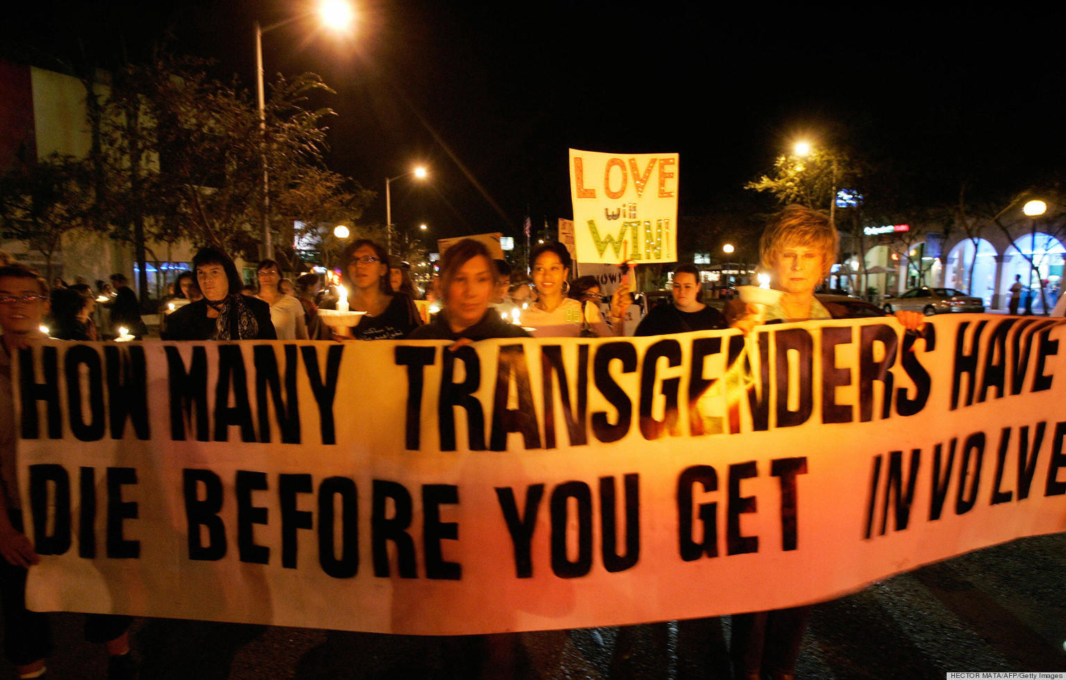 "West Hollywood, UNITED STATES: Members of the Gay, Lesbian and Transgender community demonstrate during the ""Transgender Day of Remembrance"" in West Hollywood, CA, 20 November 2006. The day was set aside to remember those who were killed due to anti-transgender hate or prejudice. The demonstration finshed at the Mathew Sheppard Square, a place that was named after the young gay man was killed because of his sexual orientation in Laramie, Wyoming in 1998. AFP PHOTO / HECTOR MATA (Photo credit should read HECTOR MATA/AFP/Getty Images)"
