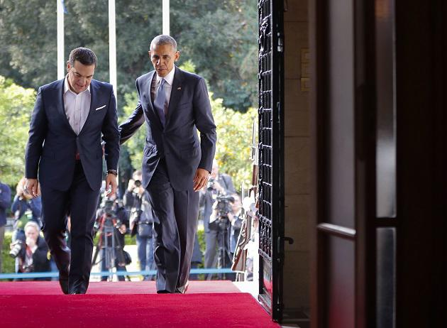 US President Barack Obama walks into the Maximos Mansion with Greek Prime Minister Alexis Tsipras to begin their joint meeting and news conference in Athens, Tuesday, Nov. 15, 2016. (AP Photo/Pablo Martinez Monsivais)