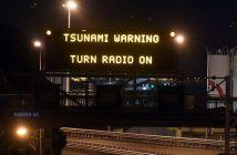 epa05630021 A motorway sign warning of a possible tsunami after an earthquake based around Cheviot in the South island hit the capital Wellington, New Zealand, early 14 November 2016. According to reports, a 7.8 magnitude earthqauke has hit New Zealand overnight, triggering a tsunami warning for the east coast of the country.  EPA/ROSS SETFORD